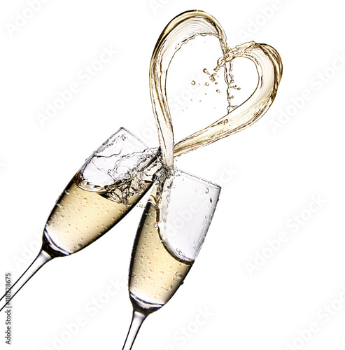 Glasses of champagne with heart shape splash isolated on a  white background