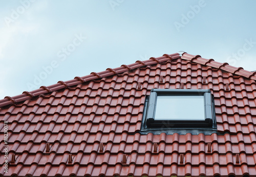 Attic skylight window on red ceramic tiles house roof outdoor. Attic ...