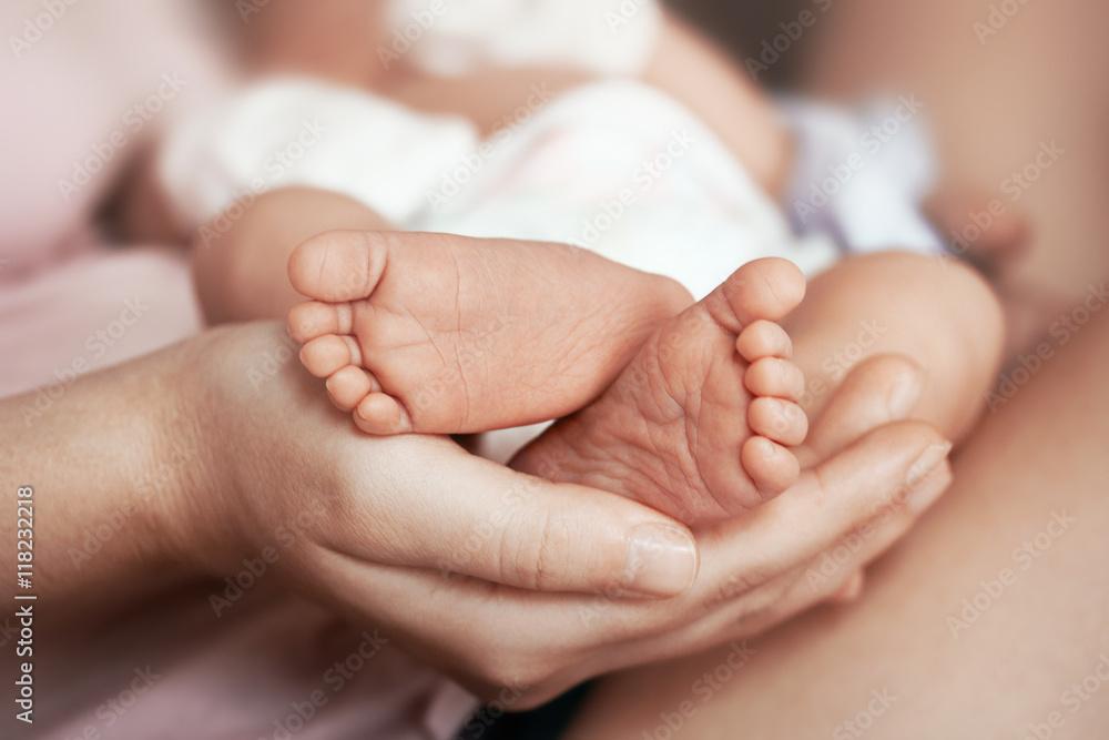 Photo  Feet of newborn baby