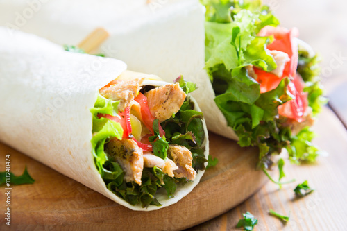 Fotografie, Obraz  Meat and vegetables wrapped in a tortilla