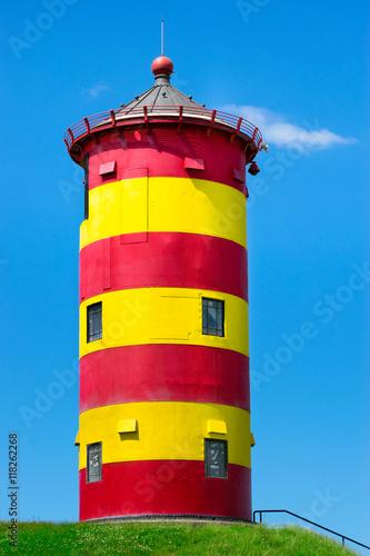 Spoed Foto op Canvas Noordzee Leuchtturm Pilsum Nordsee - Wahrzeichen Ostfrieslands - close-up