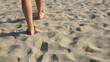Woman walking on sand beach, desert. Steadycam shot