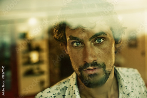 Close up portrait of serious man with beard