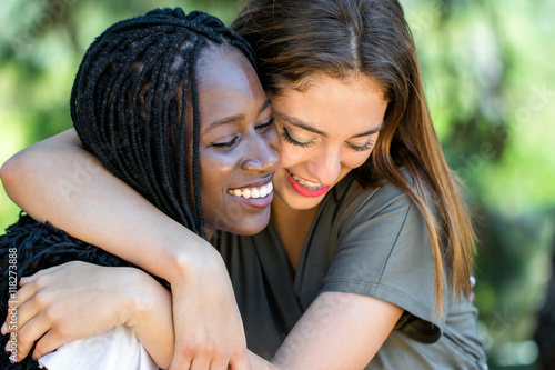 Photo  Diverse racial friends embracing outdoors.