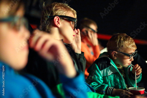фотография boys watching a movie in 3D glasses at the cinema