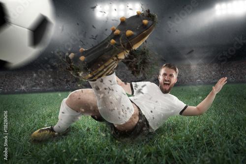 Photo  Fußballspieler bei vollem Einsatz