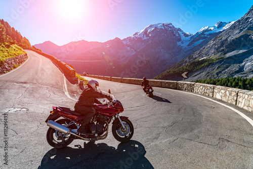 Sunset above motorbike on Passo Stelvio