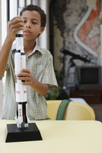Boy Building Model Rocket