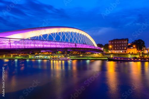 Fototapeta Bernatka footbridge over Vistula river in Krakow in the night. Poland. Europe. obraz