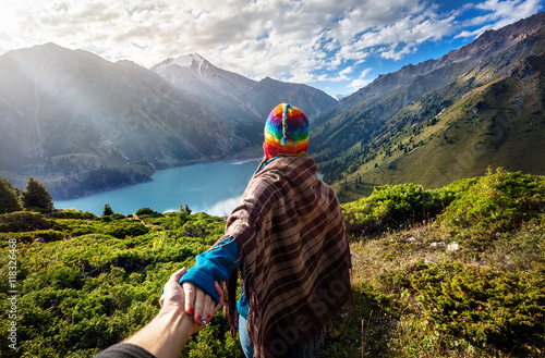 Tourist woman in rainbow hat at the mountains фототапет