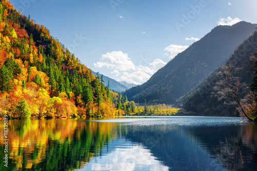 Photo Stands Lake Scenic view of the Panda Lake. Autumn woods reflected in water