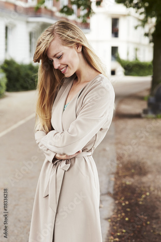 Fotografie, Obraz  Beautiful woman in overcoat, smiling