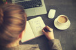 Leinwanddruck Bild - I love my job concept. Woman sitting with notebook at table