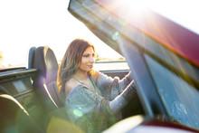 Woman Driving Convertible At S...