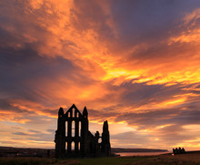 WHITBY, ENGLAND - AUGUST 12: Whitby Abbey Against A Dramatic Sunset. In Whitby, North Yorkshire, England. On 12th August 2016