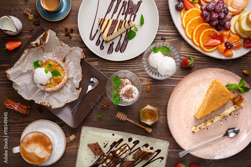 Spoed Fotobehang Dessert Different desserts with fruits