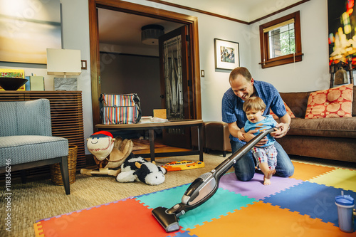Father And Son Vacuuming Living Room Buy This Stock Photo And