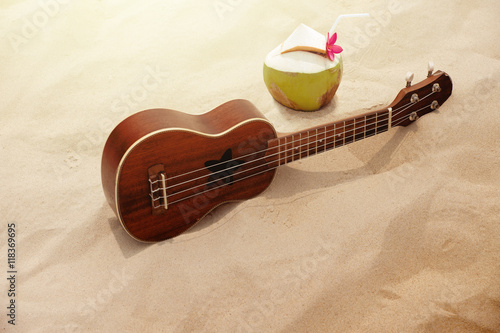 Ukulele Guitar and Coconut Water on the Sand Beach in Summer Time Wallpaper Mural