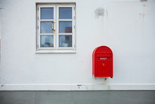 Danish Red Mailbox On The Wall