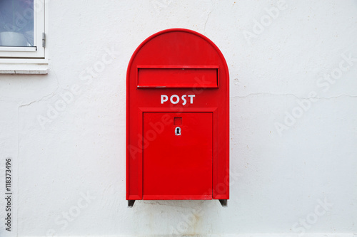 Photo  Danish red mailbox on the wall