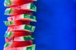 Leinwanddruck Bild - Tower of slices of watermelon on a blue background
