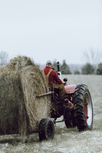 Caucasian Farmer Driving Tractor In Field
