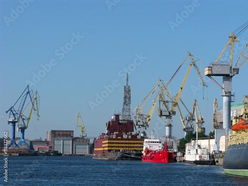 Poster Antwerpen Cargo port with cargo handling cranes, warehouses and ships