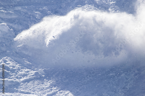 an avalanche in the mountains in winter Fotobehang