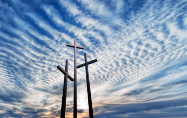 Naklejka Three crosses over bright cloudy sky