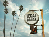 Fototapeta Młodzieżowe - aged and worn vintage photo of legal drugs sign with palm trees