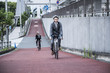 Young businessman has been commuting riding a road bike