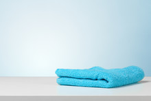 Stack Of Bath Towels On Light White Background Closeup