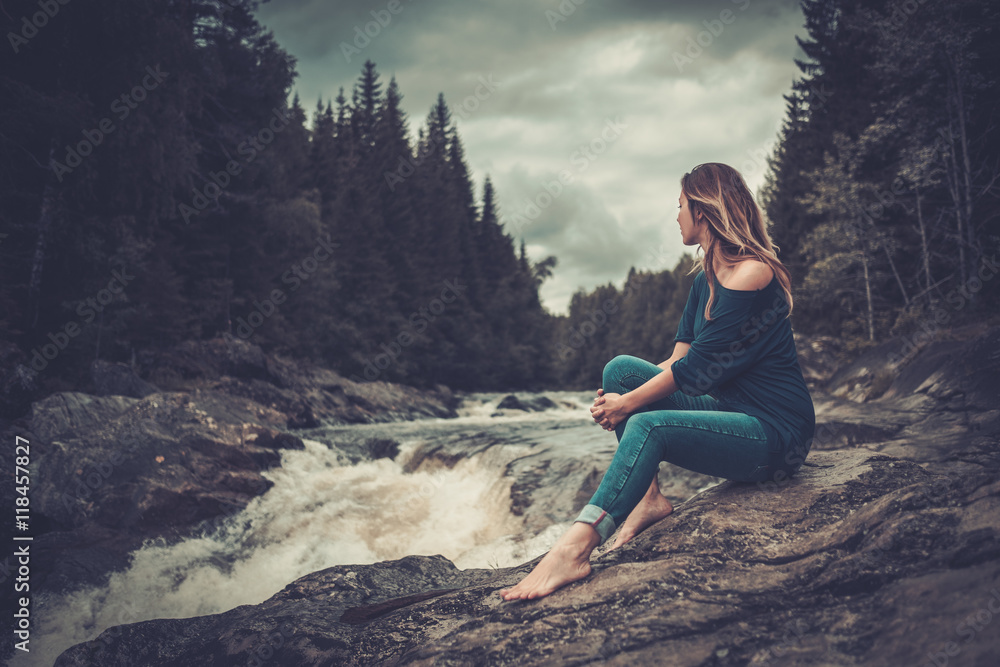 Fototapety, obrazy: Beautiful woman posing near waterfall with mountain forest on the background.