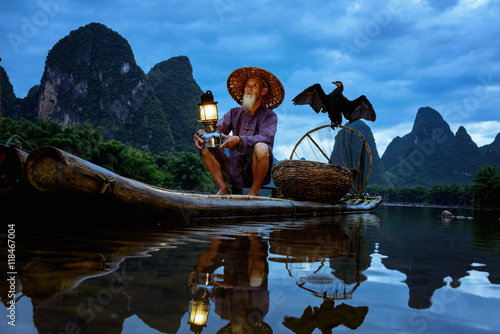 Fotobehang Guilin Fisherman of Guilin, Li River and Karst mountains during the blue hour of dawn,Guangxi China