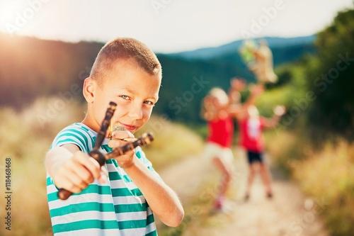 Valokuva  Boy with slingshot