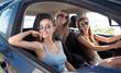 Joyful friends driving a car