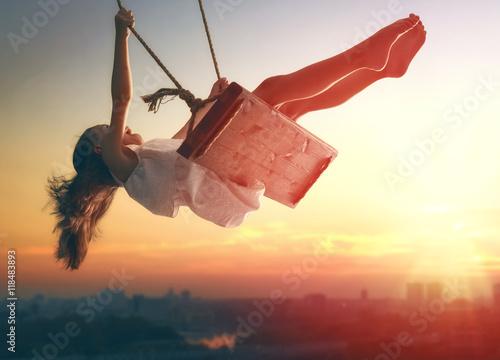child girl on swing
