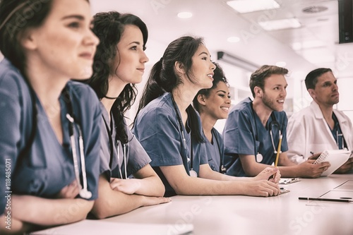 Fotografie, Obraz  Medical students listening sitting at desk