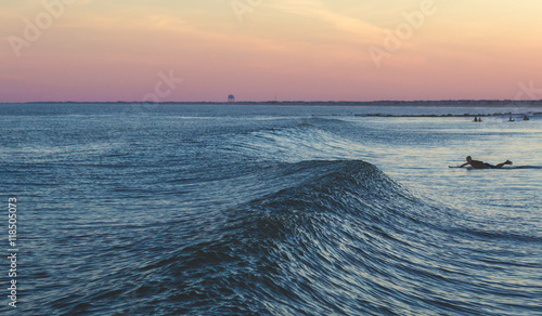 Photo  Surfing by Sunset