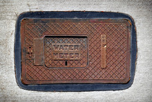 Old Rusted Water Meter Cover O...