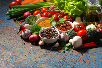 Naklejka assortment of spices and fresh organic vegetables