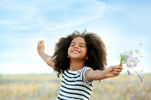 Happy Little African American Girl In The Field