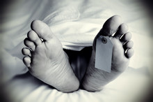 Dead Body With A Blank Toe Tag, In Monochrome
