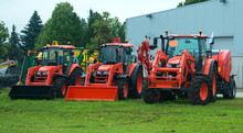 Agricultural Machinery Standing Near Hangar.