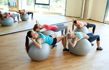 Group Of Women Exercising With...