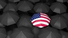 USA Flag Umbrella Over Black Umbrellas Background. 3d Illustration