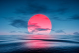 Fototapeta Sunset - a red sunset over the blue sea