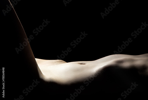 Young woman's naked belly Fototapet