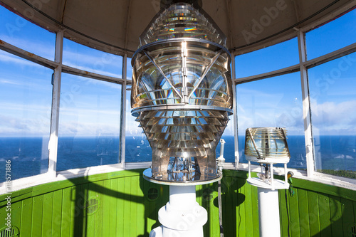 Montage in der Fensternische Leuchtturm Lighthouse glass lamp and view on the sea