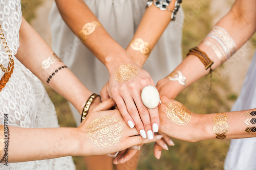 Fotografering  Close-up of female hands, three girls, best friends, flash tattoo, accessories,